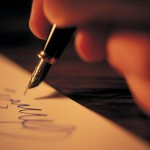 hand writing with a black fountain pen
