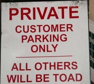 car park sign threatening non-customers will be toad