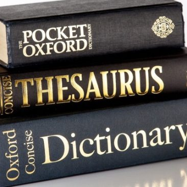 pile of dictionaires and a thesaurus