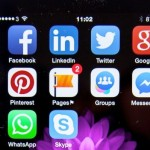 image of social media logos on a mobile phone