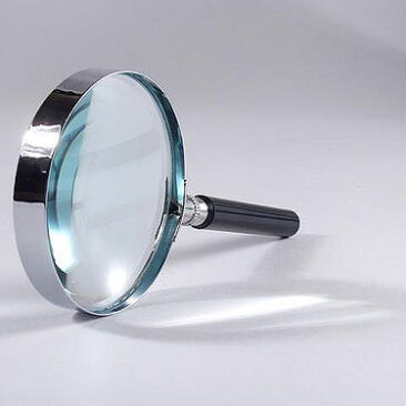 silver and glass magnifying glass