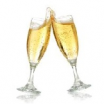 two champagne glasses, clinked together